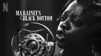 """The poster art for Ma Rainey's Black Bottom. It's a black and white picture of Viola Davis as Ma Rainey singing into a carbon microphone. She's in the middle of singing, and we can see from her neck up. Above the microphone reads """"Ma Rainey's Black Bottom."""""""