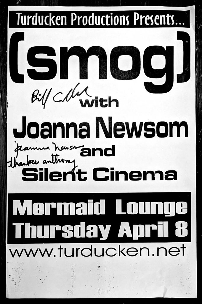 A black and white sign for a concert featuring Smog, Joanna Newsom, and Silent Cinema at the Mermaid Lounge.