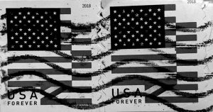 "A black and white photo of overlapping postage stamps that read ""USA Forever"" with American flags above."