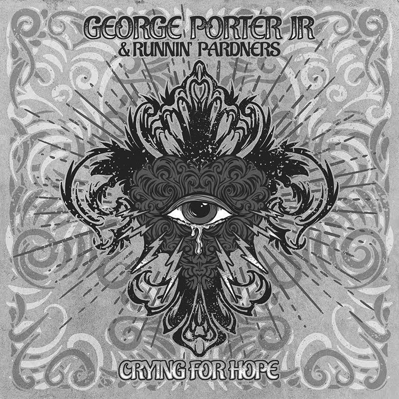 """Album cover for Crying for Hope by George Porter Jr. & the Runnin' Pardners. It's a grayscale illustration of an eye with a swirly, fleur de lis shape surrounding it. There are tiny lightning bolts around the bottom of the eye. The top reads """"George Porter Jr. & the Runnin' Pardners"""" and the bottom reads """"Crying for Hope."""""""